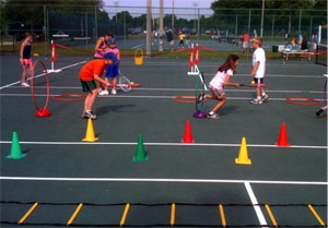 Children playing in a tennis clinic at Northdale