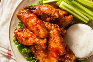 A plate of wings with celery